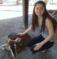 Shelly Najjar at The Goal List blog with a goat at the zoo. Photo Credit: Ayumi Kojima